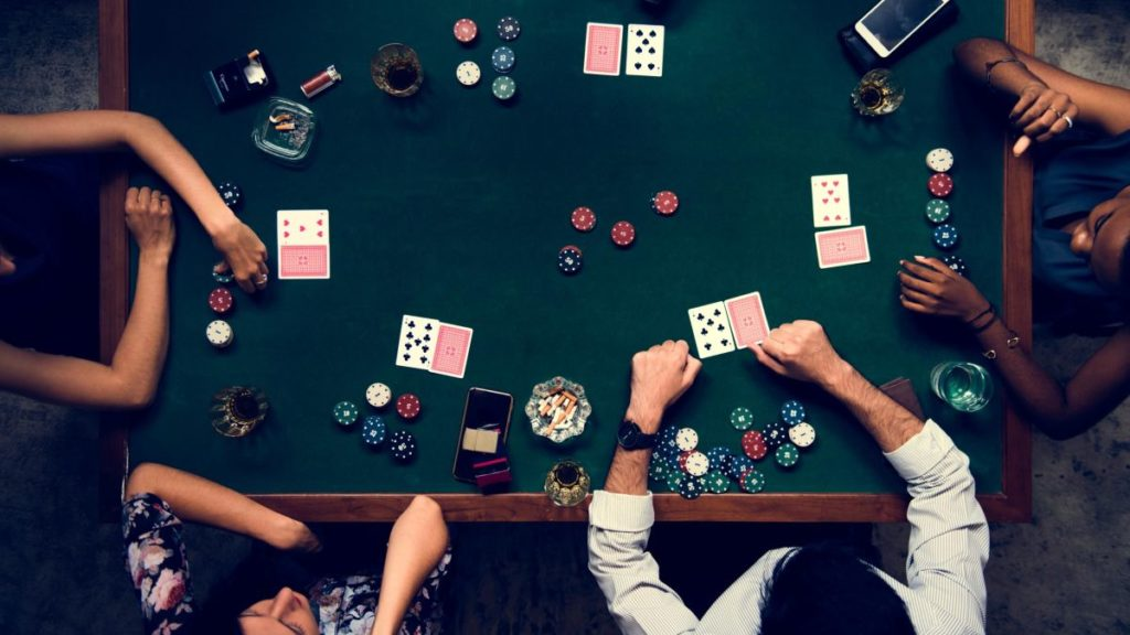 An image showing a group of people playing Poker