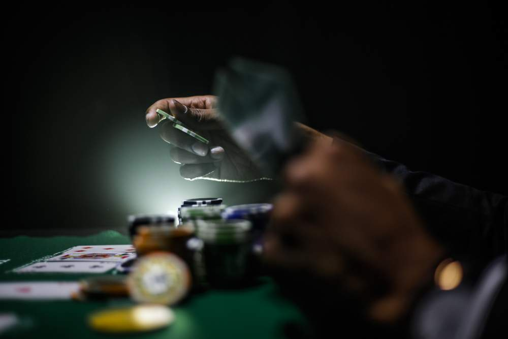An image showing a man playing poker